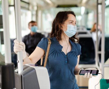 Woman with facemask on public transportation